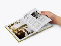 Opened Hardcover Book in a Hand Mockup - Half Side View