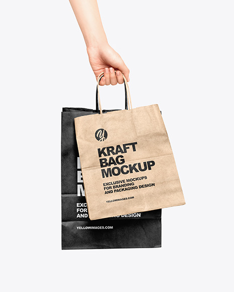Hand w/ Two Paper Bags Mockup