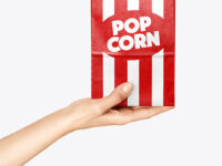 Paper Package w/ Popcorn in a Hand Mockup