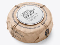 Cheese Wheel Wrapped In Kraft Paper Mockup